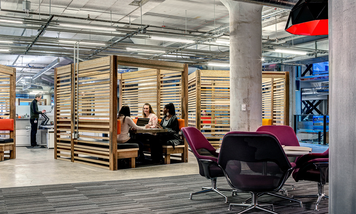 Group of wooden box breakout tables in Lowe Campbell's office
